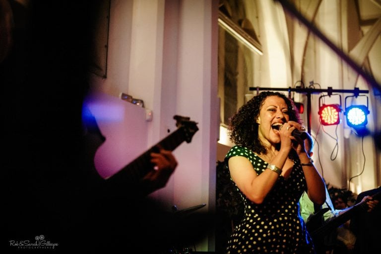 Female singer and band play at wedding party