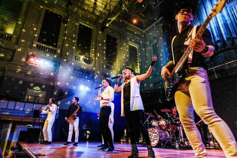 Multipiece band perform on stage at wedding party