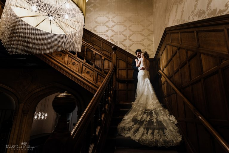 Bride and groom at night on staircase