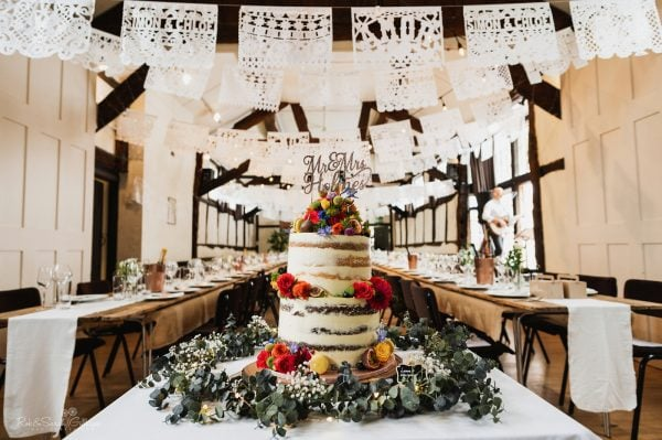Semi-naked wedding cake in village hall