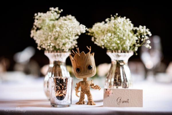 Flowers in vases and figure of Groot character wedding decoration
