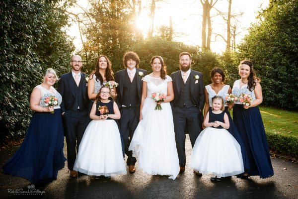 Wedding group photo with bridal party in sunshine