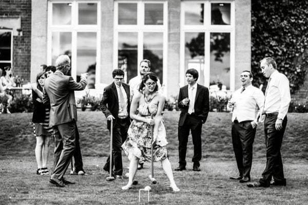 Guests play croquet during wedding reception