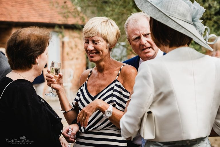 Guests laughing and relaxed at wedding reception