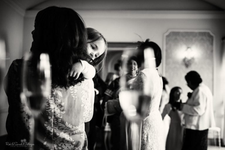 Young girl looks bored during wedding reception
