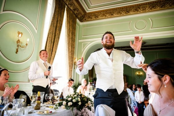 Wedding guest stands up clapping during speeches