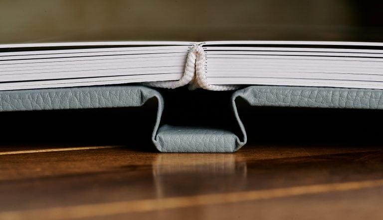Wedding album opened showing spine constructions and thickness of pages