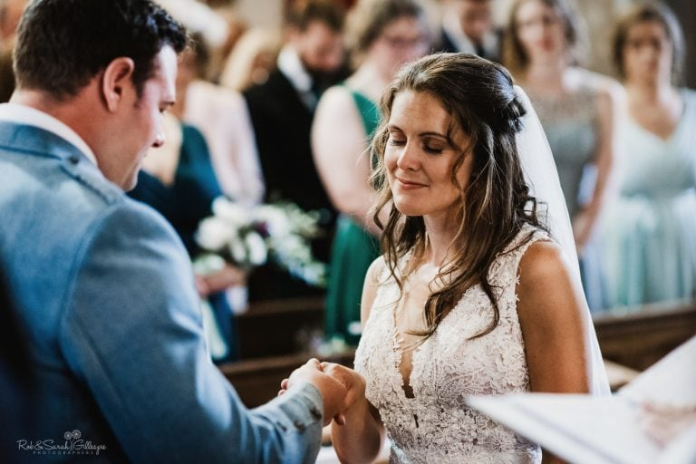 Bride closes her eyes as she listens to vows during wedding ceremony
