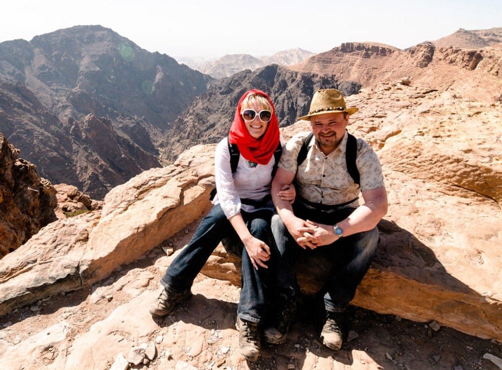 Profile picture of Rob & Sarah Gillespie sitting together on mountain top
