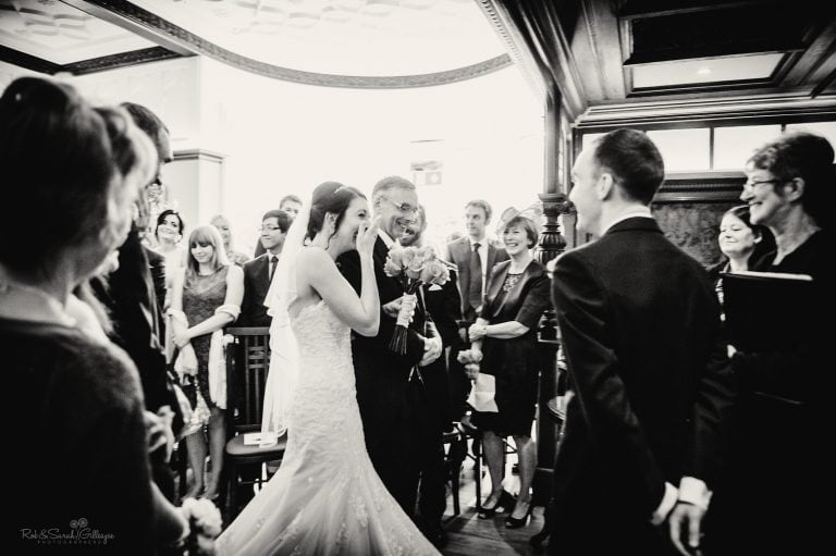 Bride emotional as she enters wedding ceremony