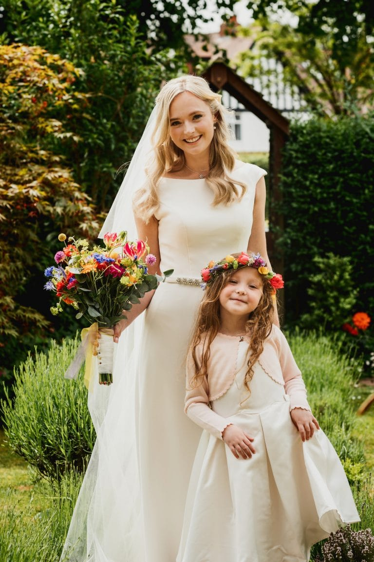 Beautiful bride and flowergirl pose for photo