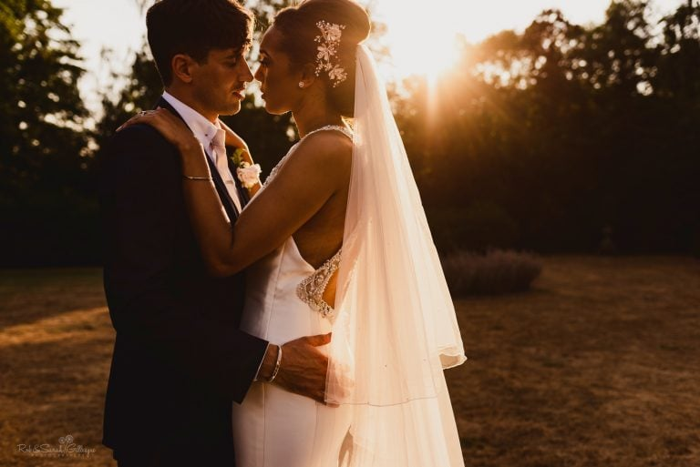 Bride and groom in beautiful sunset light