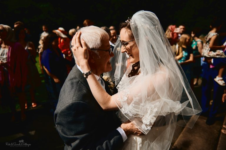 Bride emotional as she hugs grandfather after wedding