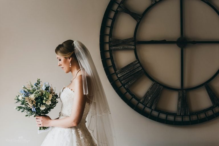 Bride portrait with large clock on wall