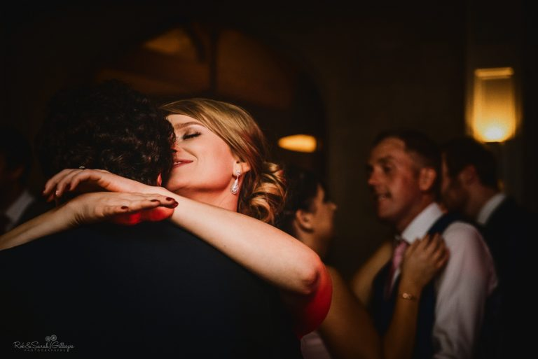 Bride smiling as she dances with new husband