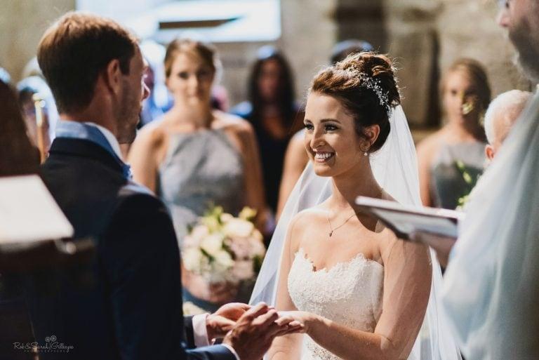 Bride smiling during wedding vows