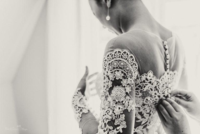 Detail of wedding dress as bride prepares