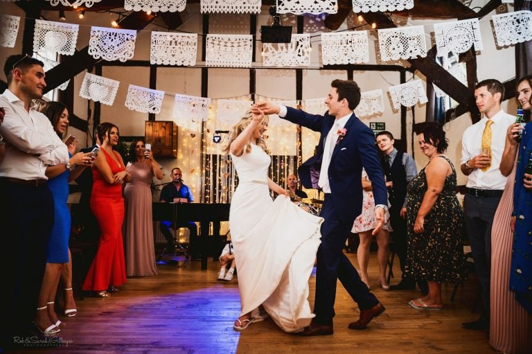 Bride and groom first dance at village hall wedding
