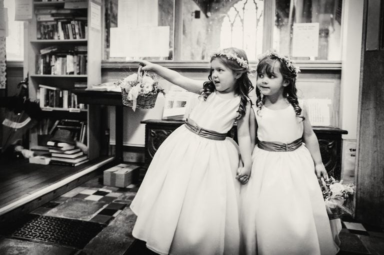 Two flowergirls waiting for bride in church