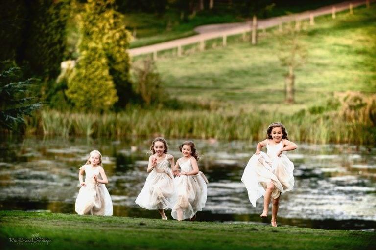 Flowergirls at wedding running across lawn