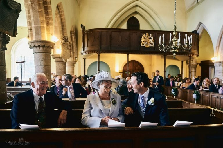 Groom chats to guests before church wedding service