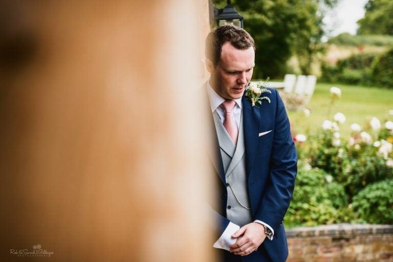 Nervous groom waits for bride