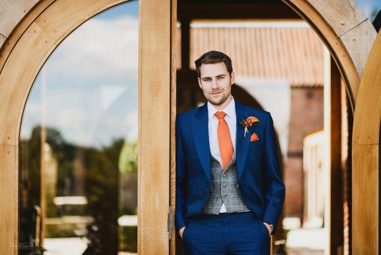 Handsome groom portrait in doorway