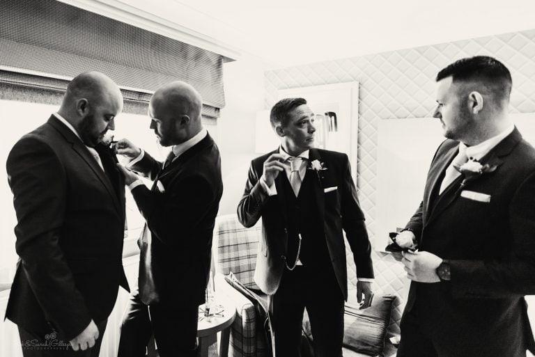 Groomsmen prepare for wedding