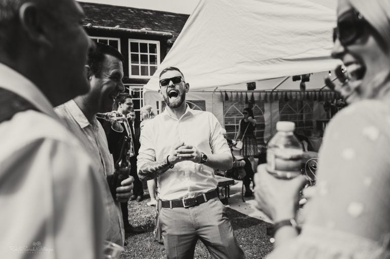 Wedding guest laughing during reception