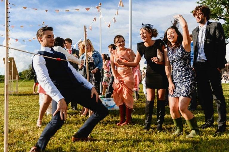 Weddin guests limbo dancing outside