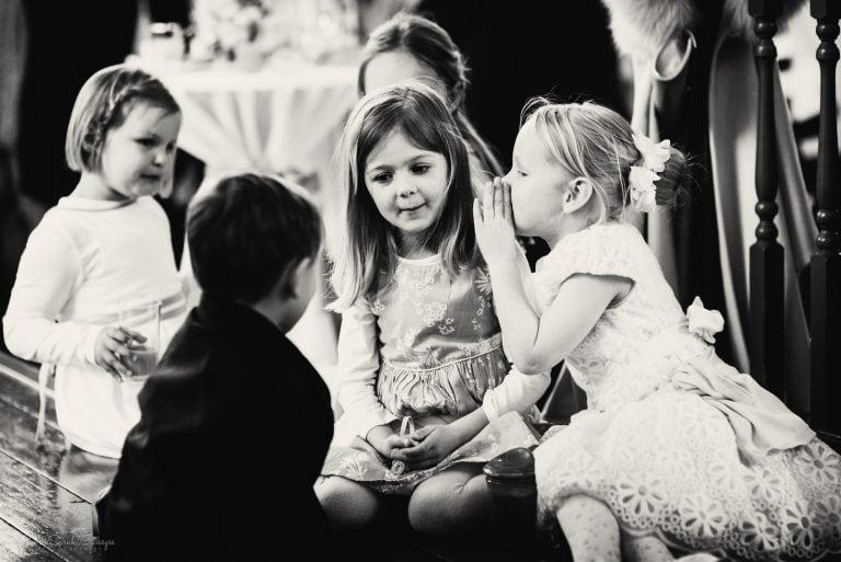 Kids whispering during wedding reception