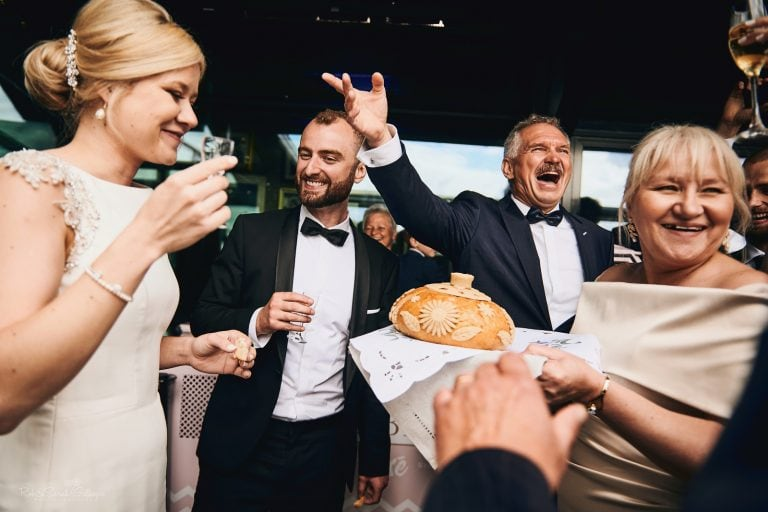 Bride and groom enjoy Polish bread and salt ceremony