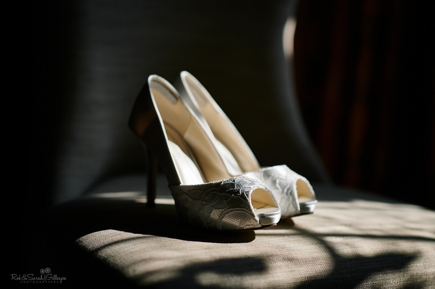 Bridal shoes on chair in strong sunlight