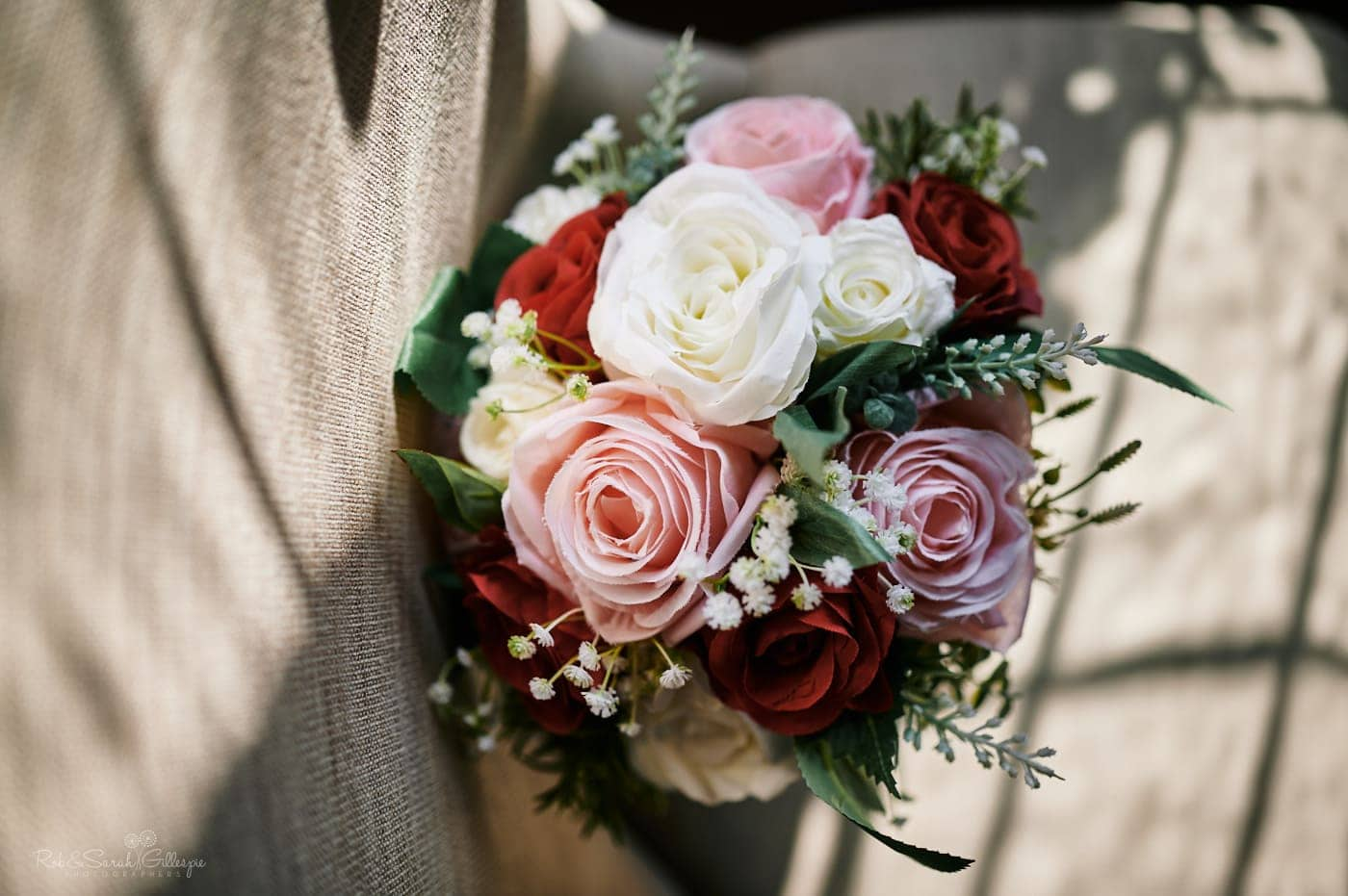 Bridal bouquet on chair in strong light