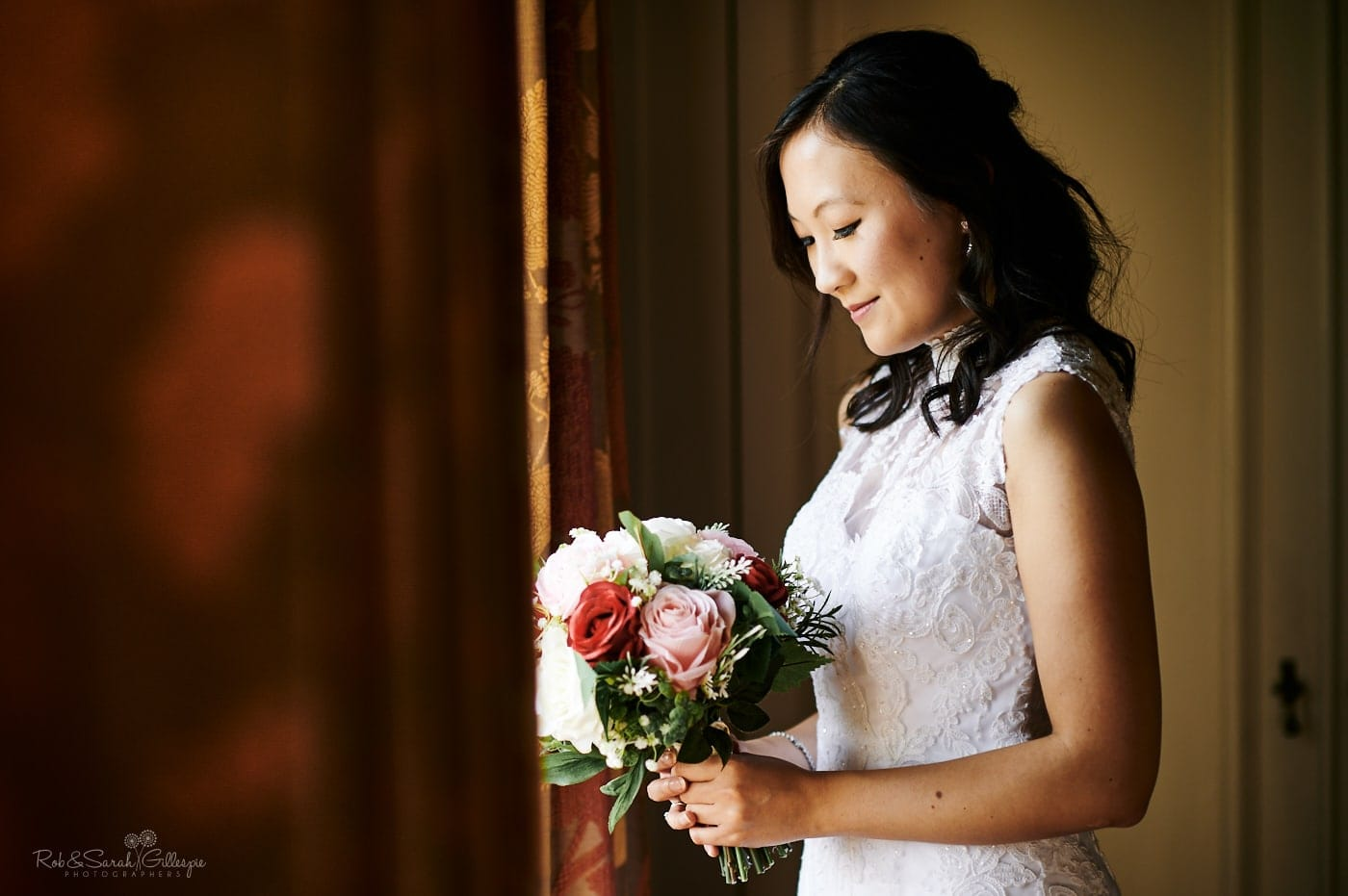 Portrait of beautiful bride in window light at Mallory Court