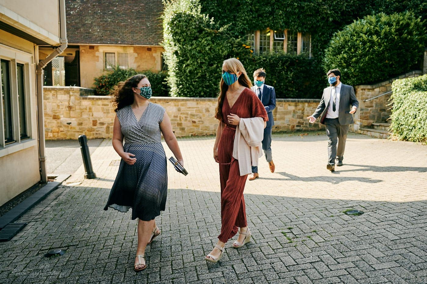 Wedding guests arrive wearing face masks for Covid wedding at Mallory Court