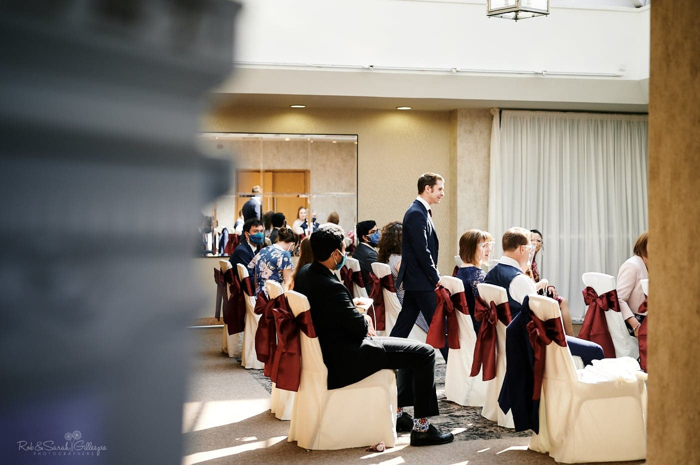 Groom waits for bride at Mallory Court wedding