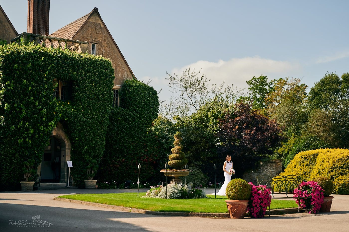 Bride walks alone to wedding ceremony at Mallory Court small wedding