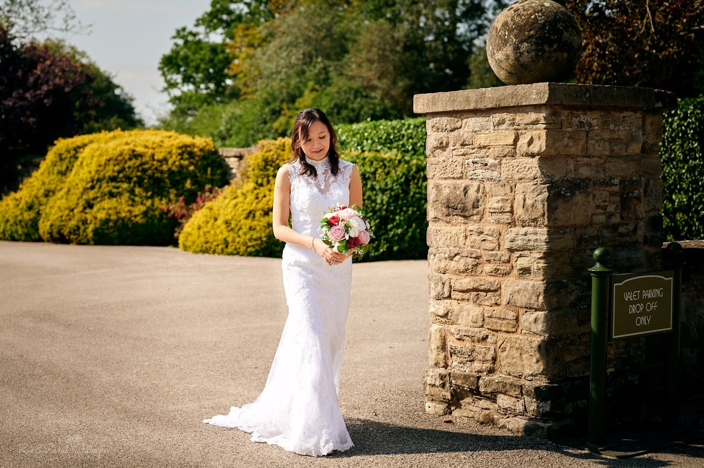 Bride in beautiful dress walks to ceremony at Mallory Court