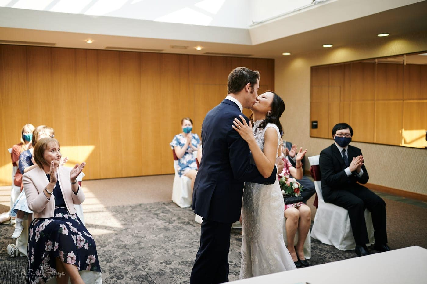 Bride and groom first kiss at Mallory Court small wedding
