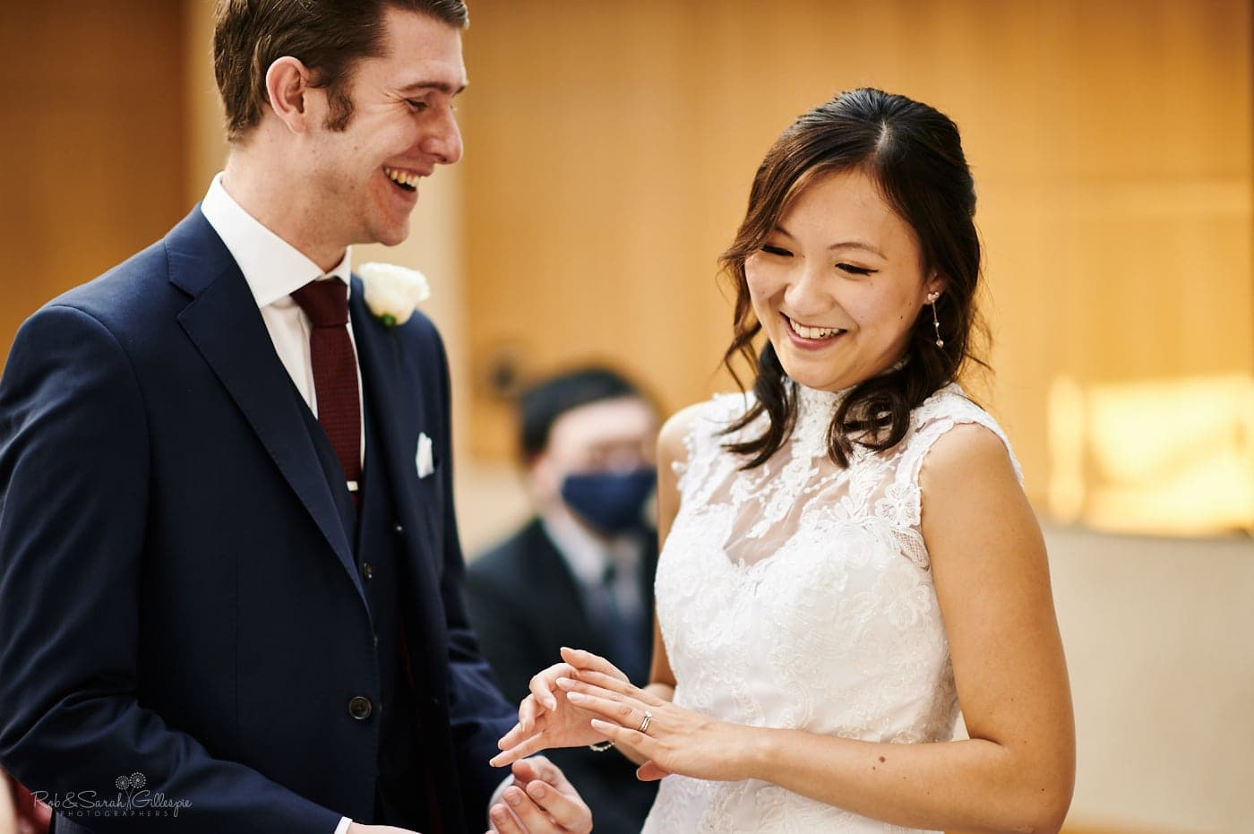 Bride and groom laughing during covid wedding ceremony at Mallory Court