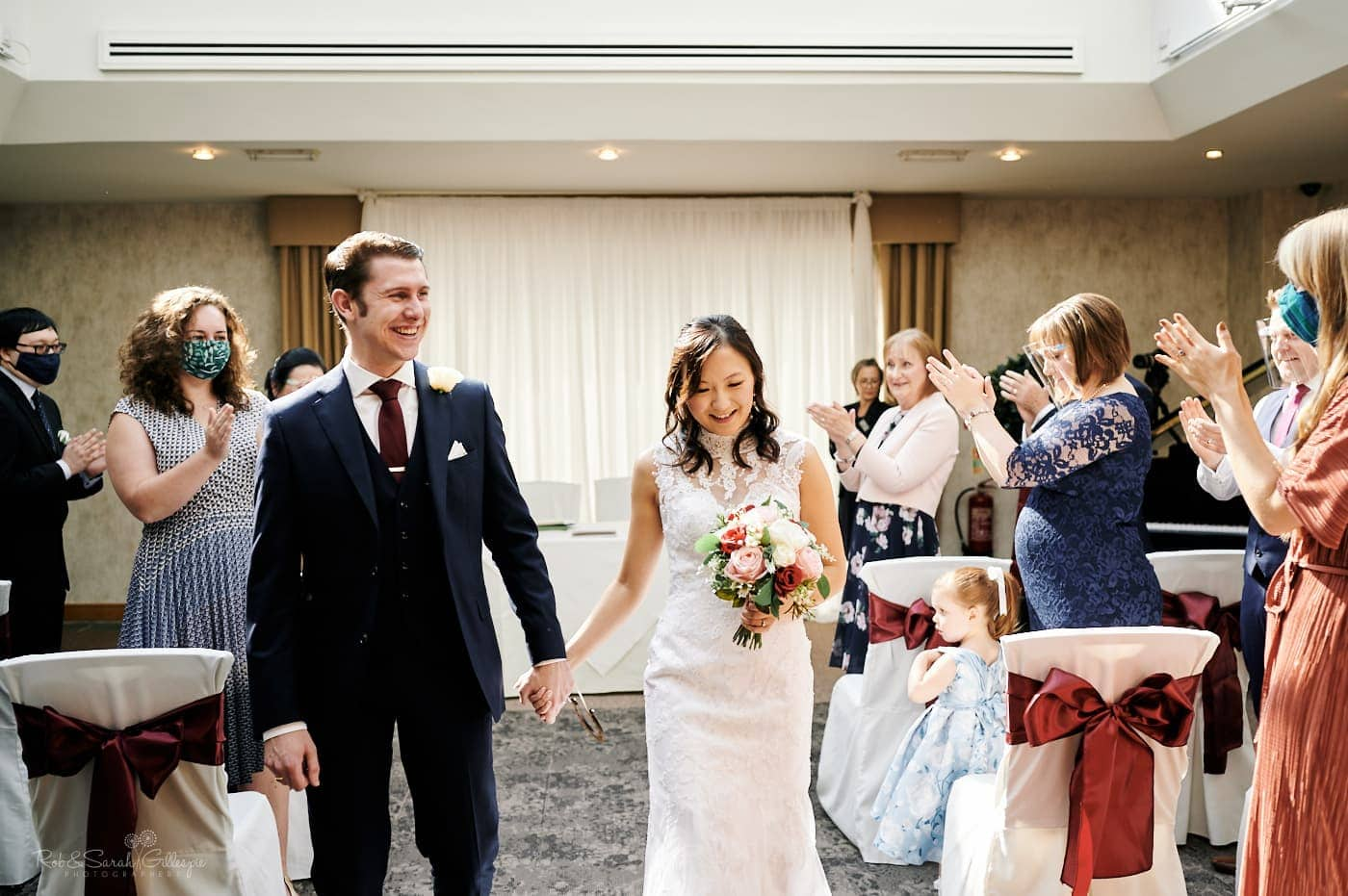 Bride and groom exit ceremony at Mallory Court