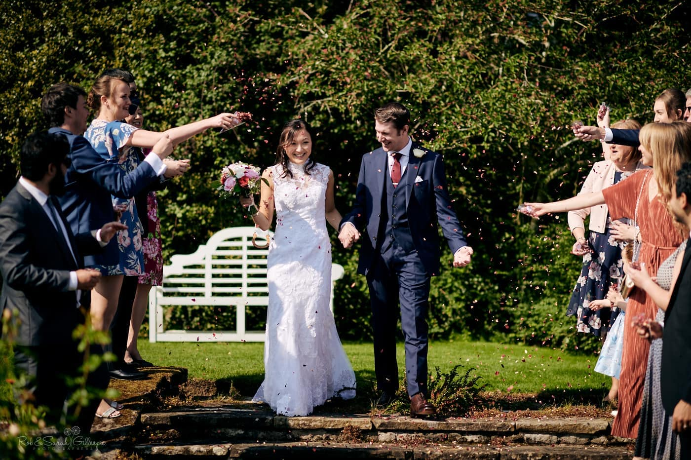 Bride and groom react to confetti throw at Mallory Court