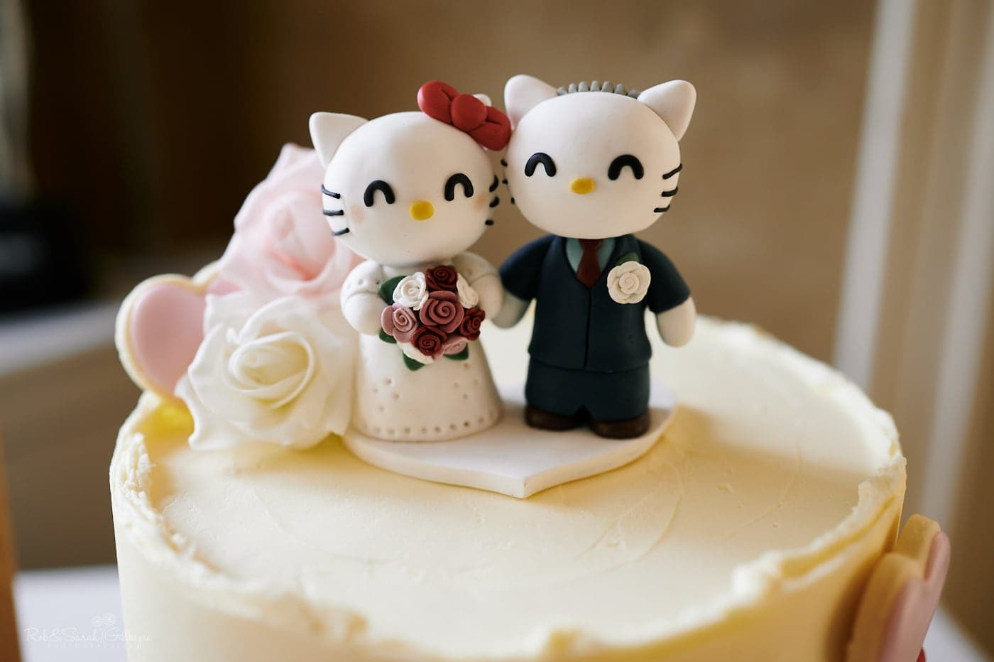 Cake topper on wedding cake in Hello Kitty style