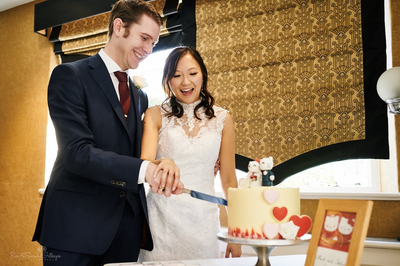 Bride and groom cut wedding cake at Mallory Court small wedding