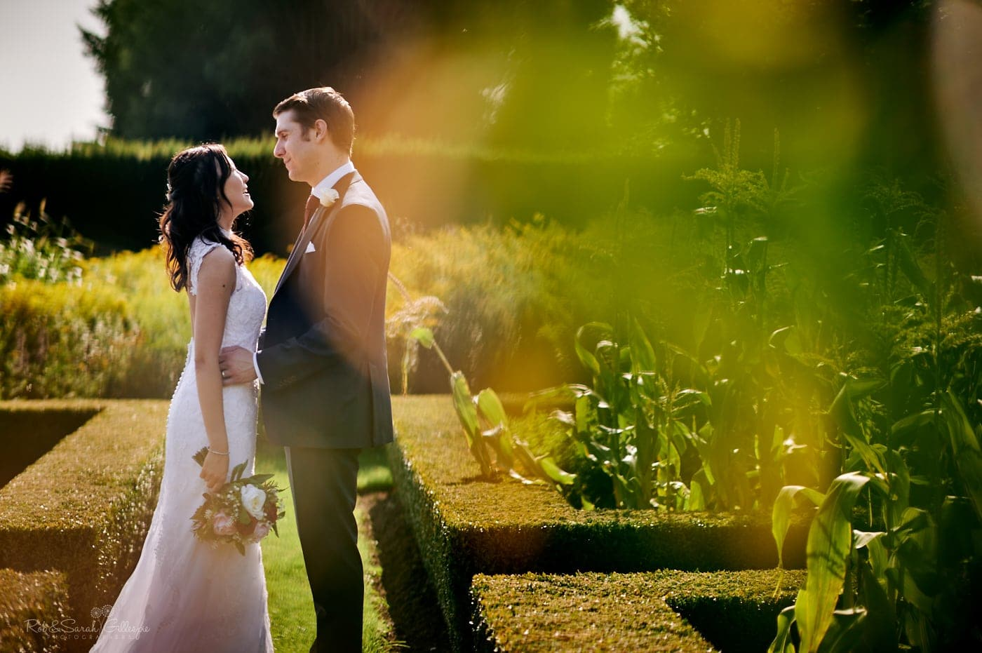 Bride and groom in gardens at Mallory Court