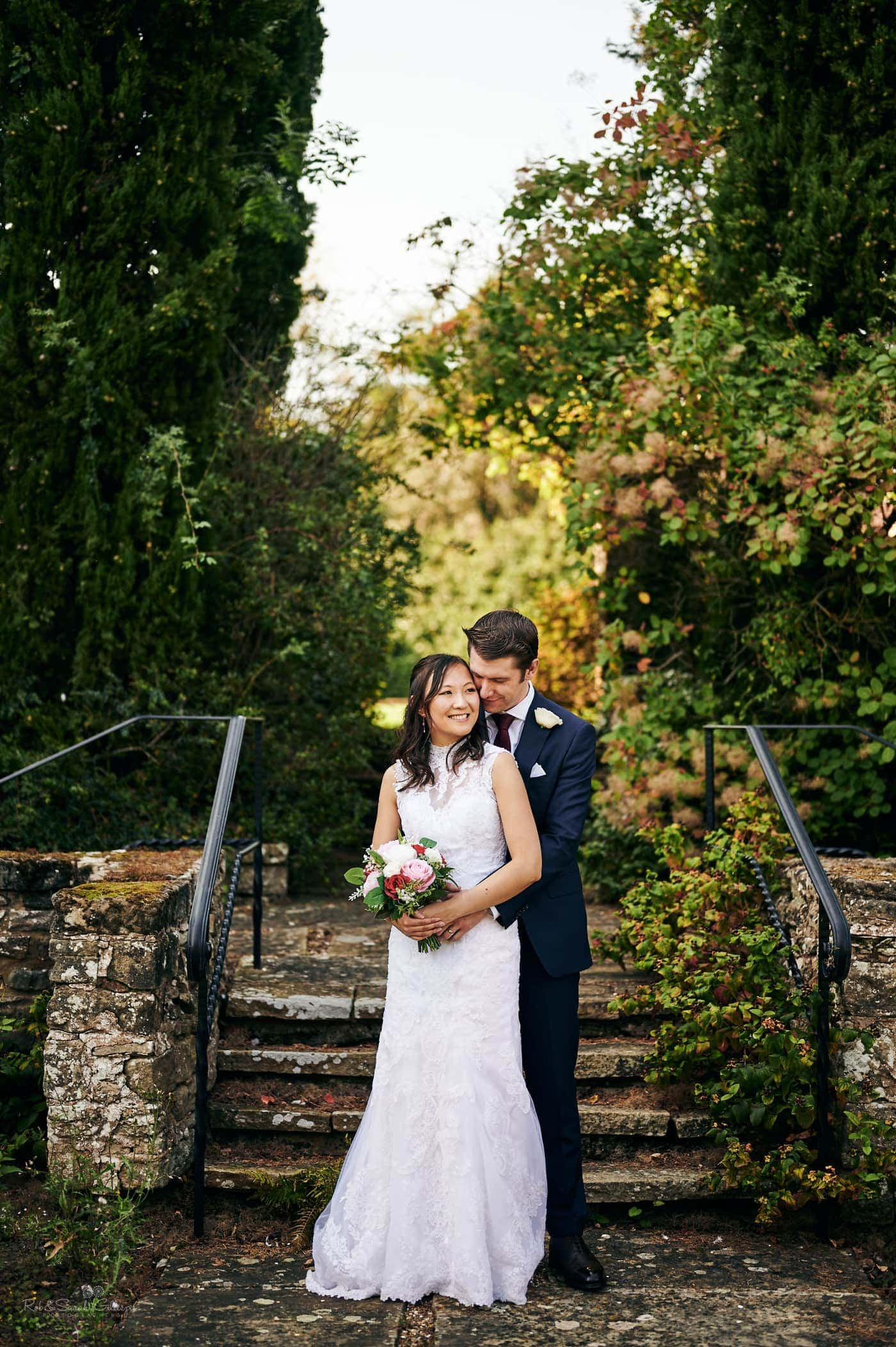 Newly married couple in Mallory Court gardens