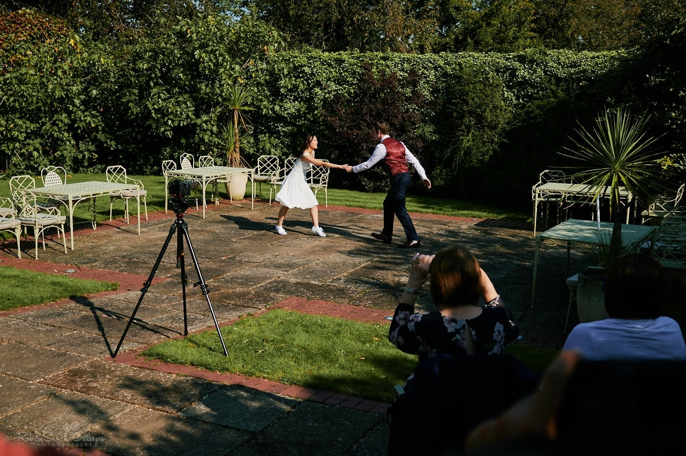 Bride and groom first dance wedding in gardens at Mallory Court