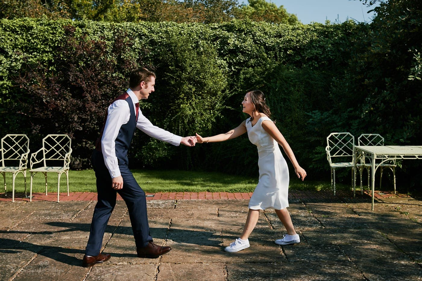 Bride and groom first dance outdoors at Mallory Court