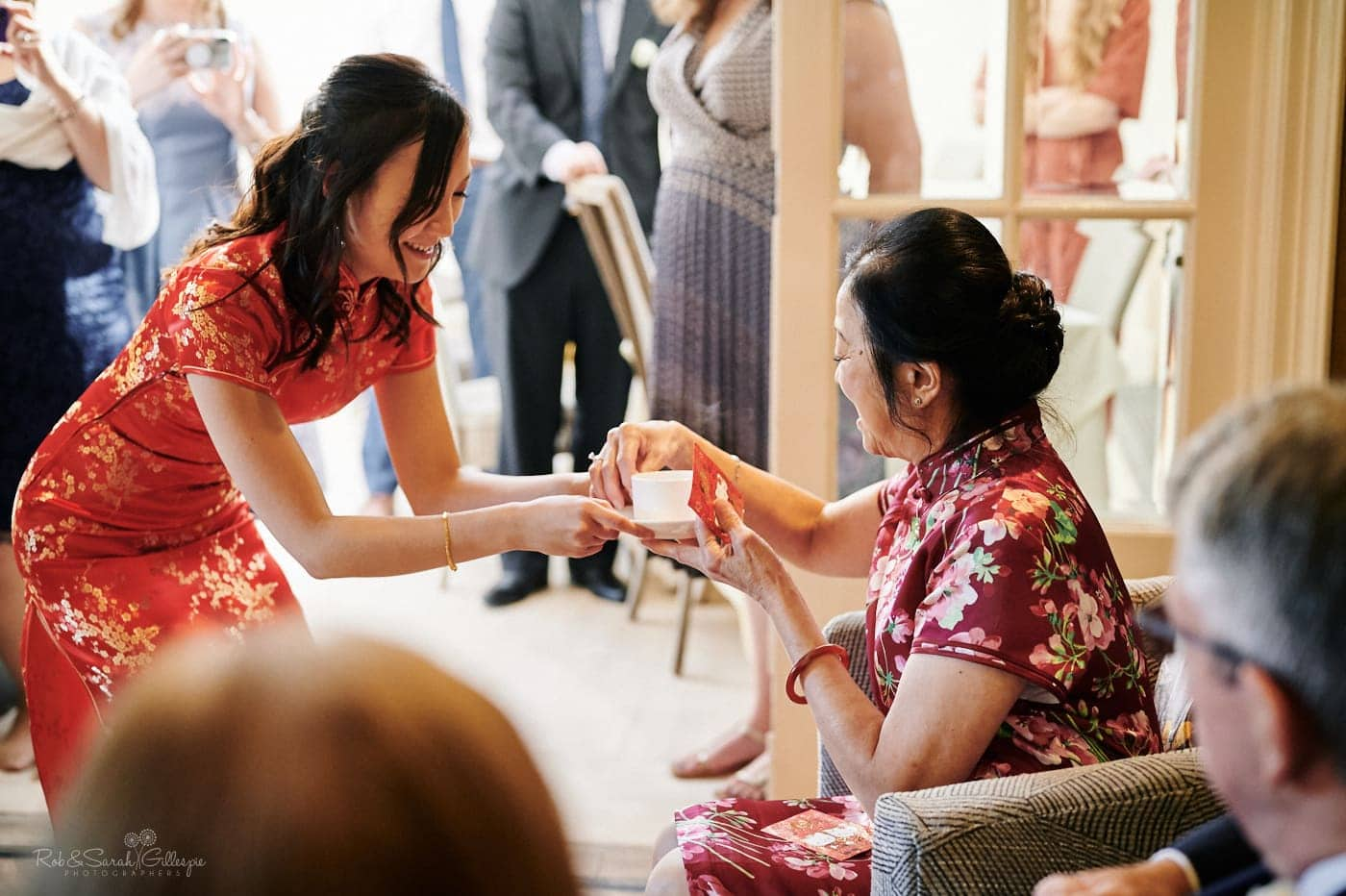 Bride and groom perform Chinese tea ceremony at Mallory Court wedding